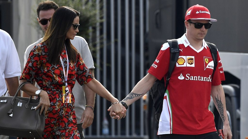 Scuderia Ferrari's Finnish driver Kimi Raikkonen (R) arrives with his wife Minttu Virtanen prior to the third practice session at the Autodromo Nazionale circuit in Monza on September 3, 2016 ahead of the Italian Formula One Grand Prix. / AFP PHOTO / GABRIEL BOUYS