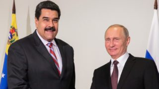 """Handout photograph released by Venezuela's Presidency showing Venezuela's President Nicolas Maduro (L) greeting his Russian counterpart, Vladimir Putin during the World Energy Congress in Istanbul, October 10, 2016.    Speaking at the World Energy Congress in Istanbul, Maduro said an informal meeting of cartel members on Wednesday that was also expected to include non-OPEC state Russia could be a first step towards creating a new alliance. / AFP PHOTO / Presidencia Venezuela / YOSET MONTES / RESTRICTED TO EDITORIAL USE - MANDATORY CREDIT """"AFP PHOTO / Venezuela's Presidency / HO """" - NO MARKETING - NO ADVERTISING CAMPAIGNS - DISTRIBUTED AS A SERVICE TO CLIENTS"""