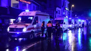 Ambulances are seen at the site of an armed attack January 1, 2017 in Istanbul. At least two people were killed in an armed attack Saturday on an Istanbul nightclub where people were celebrating the New Year, Turkish television reports said. / AFP PHOTO / YASIN AKGUL