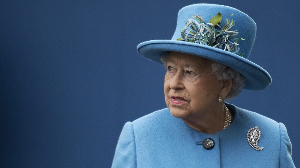 """(FILES) This file photo taken on October 27, 2016 shows  Britain's Queen Elizabeth II is photographed on a visit to the town of Poundbury, southwest England. Queen Elizabeth II will not attend a New Year's Day church service on January 1, 2017, because of a lingering """"heavy cold"""" that also forced her to stay at home on Christmas Day, Buckingham Palace said Sunday. The 90-year-old monarch, who is the supreme governor of the Church of England, will not join other members of the royal family as they attend church in Sandringham in Norfolk, eastern England. / AFP PHOTO / POOL / JUSTIN TALLIS"""