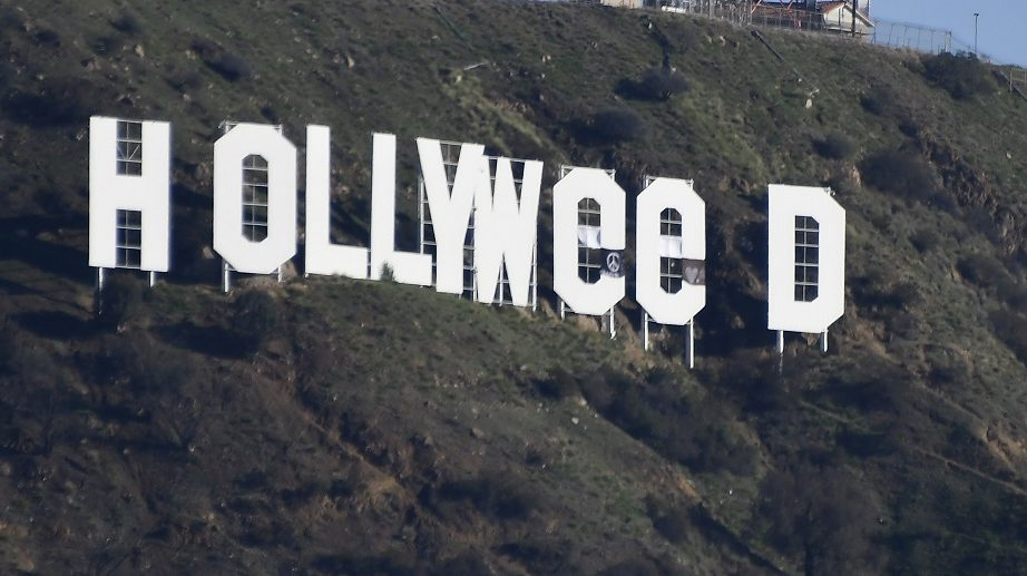 "The famous Hollywood sign reads ""Hollyweed"" after it was vandalized, January 1, 2017.   Police said unidentified thrill-seekers had climbed up and arranged tarps over the two letter ""O's"" to make them look like ""E's,"" CBS affiliate KCAL reported. Each letter is 45 feet (13.7 meters) high, so the feat would have required not just bravado but considerable athleticism.   / AFP PHOTO / Gene Blevins"