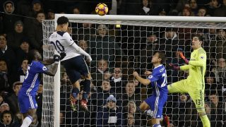 Tottenham Hotspur's English midfielder Dele Alli (2nd L) jumps to score his and Totenham's second goal with this header during the English Premier League football match between Tottenham Hotspur and Chelsea at White Hart Lane in London, on January 4, 2017. / AFP PHOTO / Adrian DENNIS / RESTRICTED TO EDITORIAL USE. No use with unauthorized audio, video, data, fixture lists, club/league logos or 'live' services. Online in-match use limited to 75 images, no video emulation. No use in betting, games or single club/league/player publications.  /