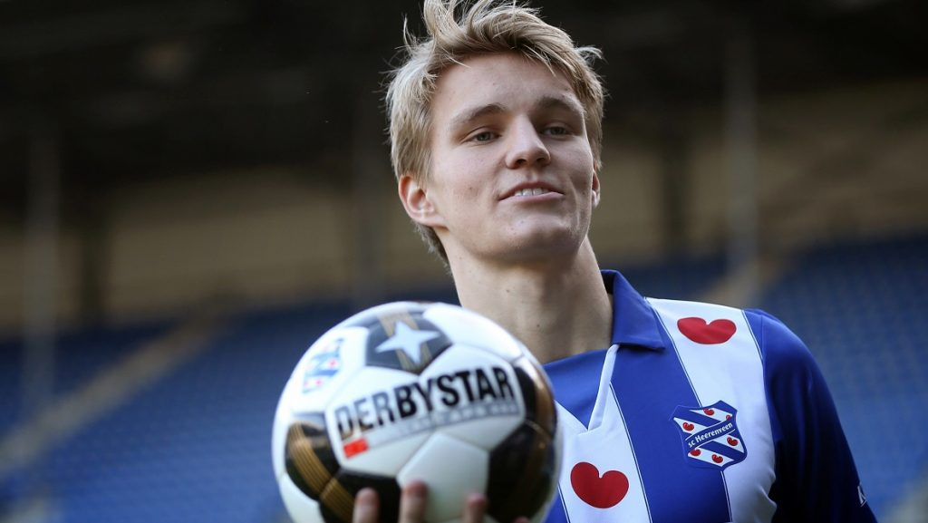 Norwegian Martin Odegaard holds a ball during his press presentation as SC Heerenveen's new player on January 10, 2017 in Heerenveen. The Frisian club rents the eighteen year old Norwegian for one and a half years of Real Madrid.  / AFP PHOTO / ANP / Catrinus van der Veen / Netherlands OUT