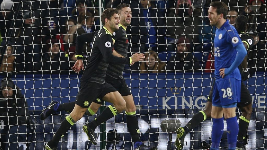 Chelsea's Spanish defender Marcos Alonso (L) celebrates with teammates after scoring their second goal during the English Premier League football match between Leicester City and Chelsea at King Power Stadium in Leicester, central England on January 14, 2017. / AFP PHOTO / Adrian DENNIS / RESTRICTED TO EDITORIAL USE. No use with unauthorized audio, video, data, fixture lists, club/league logos or 'live' services. Online in-match use limited to 75 images, no video emulation. No use in betting, games or single club/league/player publications.  /