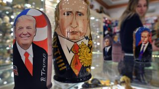 Traditional Russian wooden nesting dolls, Matryoshka dolls, depicting US President-elect Donald Trump (L) and Russian President Vladimir Putin are seen at a gift shop in central Moscow on January 16, 2017, four days ahead of Trump's inauguration. / AFP PHOTO / Alexander NEMENOV