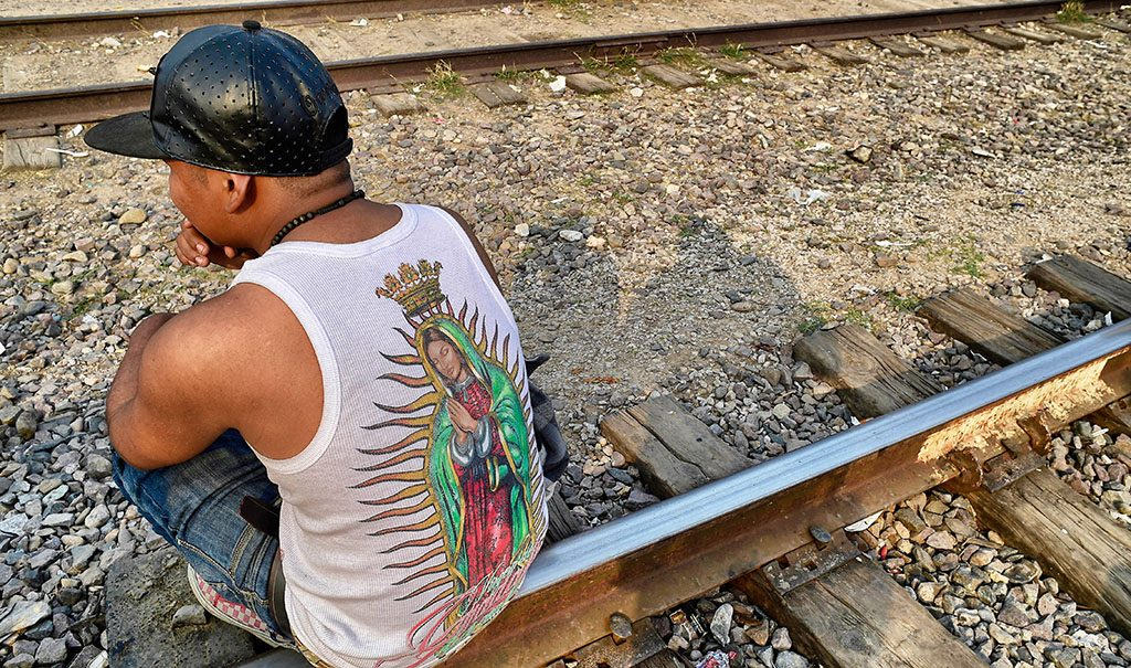 A migrant rests on the train tracks in the community of Caborca in Sonora state, Mexico, on January 12, 2017.