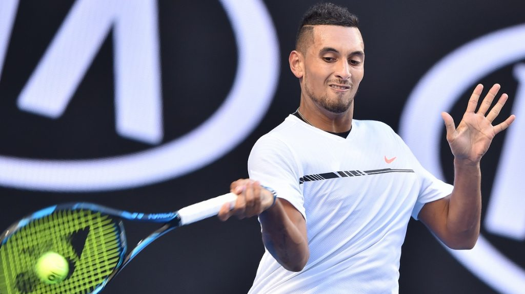 Australia's Nick Kyrgios hits a return against Italy's Andreas Seppi during their men's singles match on day three of the Australian Open tennis tournament in Melbourne on January 18, 2017. / AFP PHOTO / PETER PARKS / IMAGE RESTRICTED TO EDITORIAL USE - STRICTLY NO COMMERCIAL USE