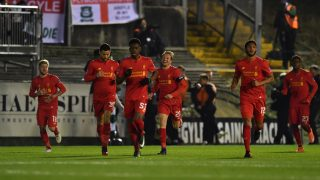 Liverpool's Brazilian midfielder Lucas Leiva (C) runs back to the half way line with teammates after scoring the opening goal of the English FA Cup third round replay football match between Plymouth Argyle and Liverpool at Home Park in Plymouth, south west England on January 18, 2017. / AFP PHOTO / Ben STANSALL / RESTRICTED TO EDITORIAL USE. No use with unauthorized audio, video, data, fixture lists, club/league logos or 'live' services. Online in-match use limited to 75 images, no video emulation. No use in betting, games or single club/league/player publications.  /