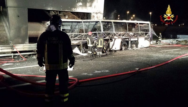 """A handout photo provided by Italy's institutional agency for fire and rescue service Vigili del Fuoco on January 21, 2017 shows firefighters extinguishing flames in the wreckage of a bus following a crash on the A4 motorway near the Verona East exit, northern Italy.  The coach carrying Hungarian teenagers home from a school trip crashed and burst into flames on the motorway in northern Italy, killing 16 people, firefighters said Saturday. Some 39 injured were taken to hospital following the accident near Verona on Friday night, which occurred when the vehicle smashed into a bridge pillar, according to emergency workers.  / AFP PHOTO / Vigili del Fuoco / Handout / RESTRICTED TO EDITORIAL USE - MANDATORY CREDIT """"AFP PHOTO / VIGILI DEL FUOCO"""" - NO MARKETING NO ADVERTISING CAMPAIGNS - DISTRIBUTED AS A SERVICE TO CLIENTS"""