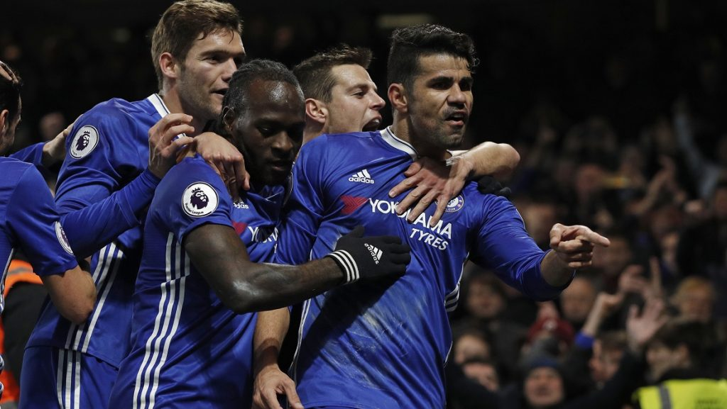 Chelsea's Brazilian-born Spanish striker Diego Costa (R) gestures as he celebrates with teammates after scoring the opening goal of the English Premier League football match between Chelsea and Hull City at Stamford Bridge in London on January 22, 2017. / AFP PHOTO / Adrian DENNIS / RESTRICTED TO EDITORIAL USE. No use with unauthorized audio, video, data, fixture lists, club/league logos or 'live' services. Online in-match use limited to 75 images, no video emulation. No use in betting, games or single club/league/player publications.  /