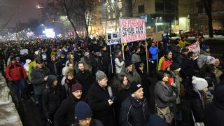 Protesters march during a protest against the corruption and the government in Bucharest, on January 22, 2017. Tens of thousand of protesters rally on Sunday in Romania's biggest cities against the corruption and government as Romania's president on Wednesday held a series of controversial legal changes that would have protected corrupt politicians in the graft-tainted country from prosecution. The move came as the Social Democrat leader Liviu Dragnea, whose PSD (Social Democrat Party) party won last month's parliamentary elections, preparing to go on trial for alleged abuse of power. The bill sought to decriminalize certain offenses and redefine what constitutes an abuse of power. The justice minister had hoped to pass the proposals by emergency decree in Wednesday's cabinet meeting, which would have seen them enter into effect immediately. A previous attempt in 2013 to pass the legal amendments was dropped after protests from non-governmental organizations. / AFP PHOTO / DANIEL MIHAILESCU
