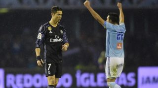 Real Madrid's Portuguese forward Cristiano Ronaldo (L) reacts being thrown out of the competition at the end of the Spanish Copa del Rey (King's Cup) quarter final second leg football match RC Celta de Vigo vs Real Madrid CF RC Celta de Vigo on January 25, 2017. A fine free-kick from Cristiano Ronaldo couldn't prevent Real Madrid from being dumped out of the Copa del Rey as a 2-2 draw at Celta Vigo today allowed the hosts to progress to the semi-finals 4-3 on aggregate. / AFP PHOTO / MIGUEL RIOPA