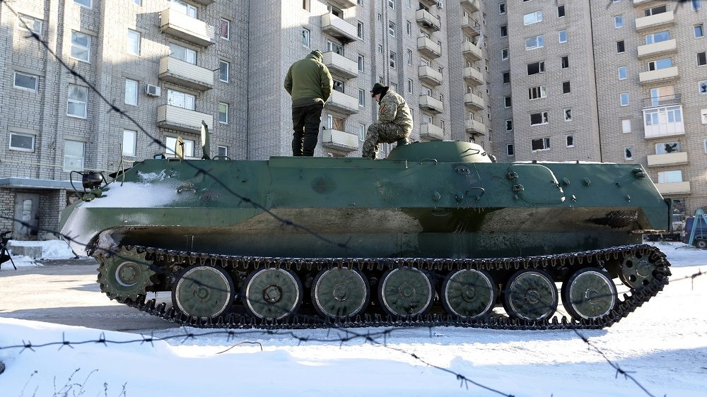 """Ukrainian medical servicemen stand on an Armoured Personnel Carriers (APC) after they carried wounded servicemen to hospital in Ukraine-controlled town of Avdiivka, in Donetsk region on January 30, 2017. A sudden surge in clashes between Ukrainian forces and Russian-backed rebels killed at least six people on January 30, 2017 despite a supposed truce in Ukraine's war-scarred east. The overall death toll for the past two days rose to 11 after the bloodiest outburst of violence since the former Soviet republic and its foes agreed an """"indefinite"""" ceasefire last month. The violence coincided with a visit by Ukrainian Petro Poroshenko to Berlin at which he urgend German Chancellor Angela Merket to step up economic sanctions on Russia for its interference in his ex-Soviet State. / AFP PHOTO / Aleksey FILIPPOV"""