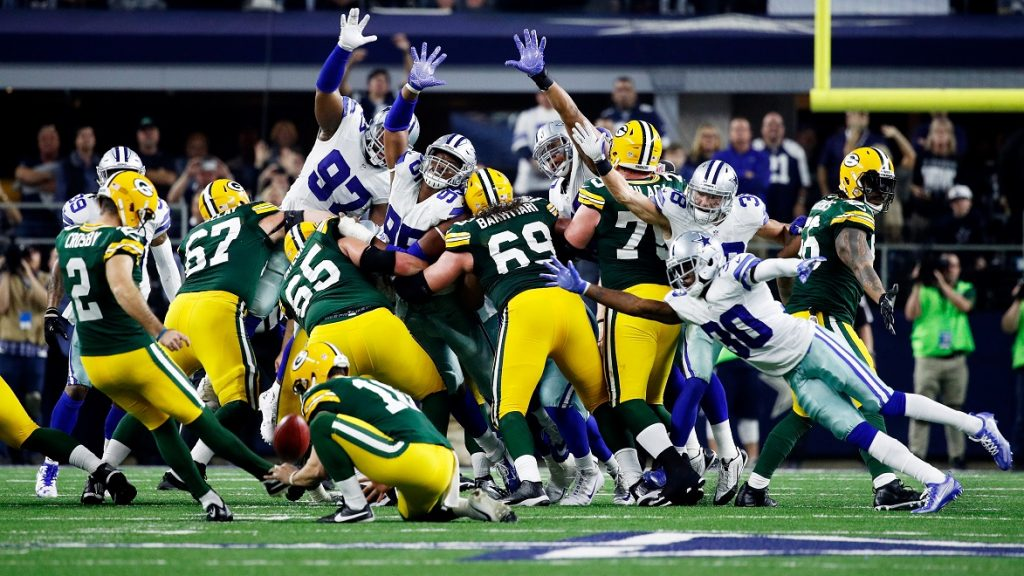 ARLINGTON, TX - JANUARY 15: Mason Crosby #2 of the Green Bay Packers kicks a field goal to beat the Dallas Cowboys 34-31 in the NFC Divisional Playoff Game at AT&T Stadium on January 15, 2017 in Arlington, Texas.   Joe Robbins/Getty Images/AFP