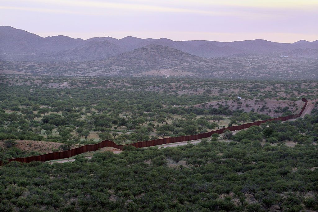 SASABE, AZ - JUNE 01: A massive steel fence built by the United States to deter illegal immigration separates the United States and Mexico June 1, 2010 near Sasabe, Arizona. During the 2009 fiscal year 540,865 undocumented immigrants were apprehended entering the United States illegally along the Mexican border, 241,000 of those were captured in the 262 mile stretch of the border known as the Tucson Sector.   Scott Olson/Getty Images/AFP