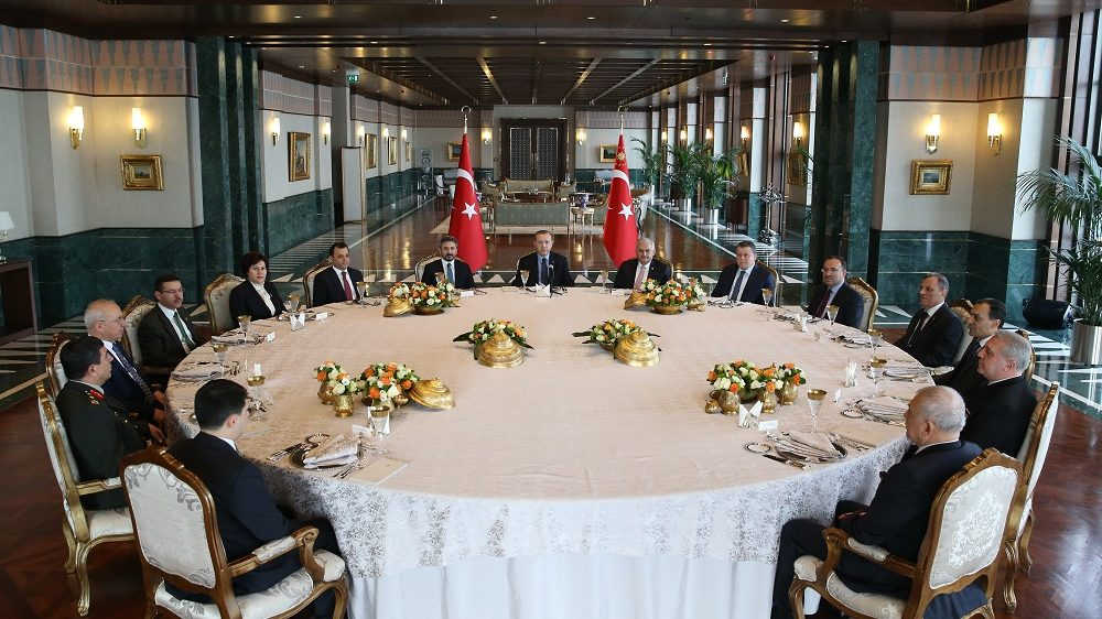 ANKARA, TURKEY - JANUARY 03 : Turkish President Recep Tayyip Erdogan (C), Turkish Prime Minister Binali Yildirim (C-R), Deputy Speaker of the Turkey's Grand National Assembly Ahmet Aydin (C-L) and Turkey's Minister of Justice Bekir Bozdag (5th R) attend a luncheon with heads of legislative, judicial and executive branches of the state at the Presidential Complex in Ankara, Turkey on January 03, 2017. Turkish Presidency / Yasin Bulbul / Anadolu Agency