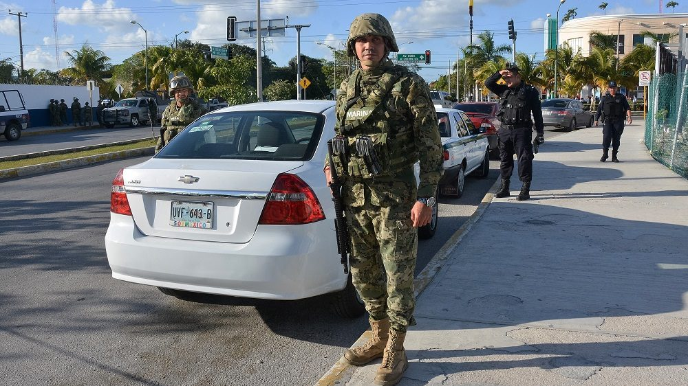 CANCUN, MEXICO - JANUARY 17: Marines patrol near the State Prosecutor Office where a group of gunmen attacked the place in Cancun, Mexico on January 17, 2017. Shootings left four people dead and five detainees. Cancun is one of the most iconic tourist destinations in Mexico, receiving millions of tourists a year from all around the world.  Stringer / Anadolu Agency