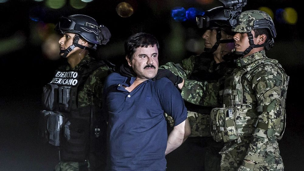 """MEXICO CITY, MEXICO - JANUARY 8: Joaquin Guzman Loera, also known as """"El Chapo"""" is transported to Maximum Security Prison of El Altiplano in Mexico City, Mexico on January 08, 2016. Guzman Loera, leader of Mexico's Sinaloa drug Cartel, was considered the Mexican most-wanted drug lord. Mexican marines captured """"El Chapo"""" on Friday in Sinaloa, North of Mexico. Daniel Cardenas / Anadolu Agency"""