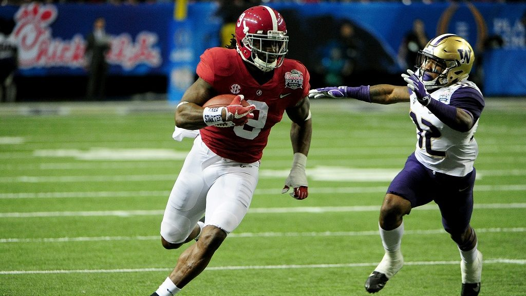 ATLANTA, GA - DECEMBER 31: Bo Scarbrough #9 of the Alabama Crimson Tide runs the ball against the Washington Huskies during the 2016 Chick-fil-A Peach Bowl at the Georgia Dome on December 31, 2016 in Atlanta, Georgia.   Scott Cunningham/Getty Images/AFP