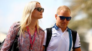 ABU DHABI, UNITED ARAB EMIRATES - NOVEMBER 28:  Valtteri Bottas of Finland and Williams and Emilia Pikkarainen walk in the paddock before final practice for the Abu Dhabi Formula One Grand Prix at Yas Marina Circuit on November 28, 2015 in Abu Dhabi, United Arab Emirates.  (Photo by Mark Thompson/Getty Images)