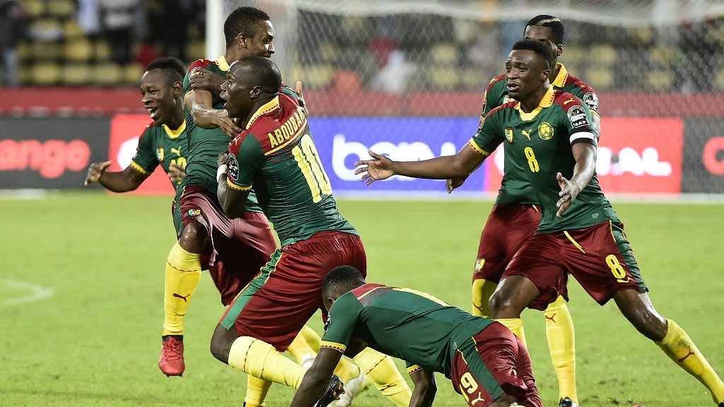Cameroon's players celebrate after winning the penalty shootout at the end of the 2017 Africa Cup of Nations quarter-final football match between Senegal and Cameroon in Franceville on January 28, 2017. / AFP PHOTO / KHALED DESOUKI