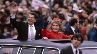 WASHINGTON  - JANUARY 20:  (NO U.S. TABLOID SALES)  U.S. President Ronald Reagan and wife Nancy wave to the crowd from the Presidential Limosine as they ride down Pennsylvania Avenue during the Inaugural parade January 20, 1981 in Washington, DC.  (Photo by David Hume Kennerly/Getty Images)