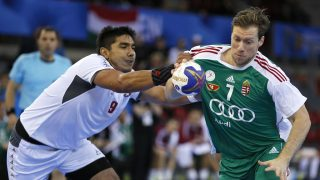 Hungary's centre back Gabor Csaszar (R) works around Chile's pivot Javier Frelijj during the 25th IHF Men's World Championship 2017 Group C handball match Hungary vs Chile on January 16, 2017 at the Kindarena in Rouen. / AFP PHOTO / CHARLY TRIBALLEAU