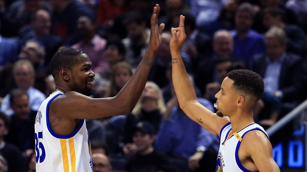 TORONTO, ON - NOVEMBER 16: Kevin Durant #35 and Steph Curry #30 of the Golden State Warriors high five during the first half of an NBA game against the Toronto Raptors at Air Canada Centre on November 16, 2016 in Toronto, Canada. NOTE TO USER: User expressly acknowledges and agrees that, by downloading and or using this photograph, User is consenting to the terms and conditions of the Getty Images License Agreement.   Vaughn Ridley/Getty Images/AFP