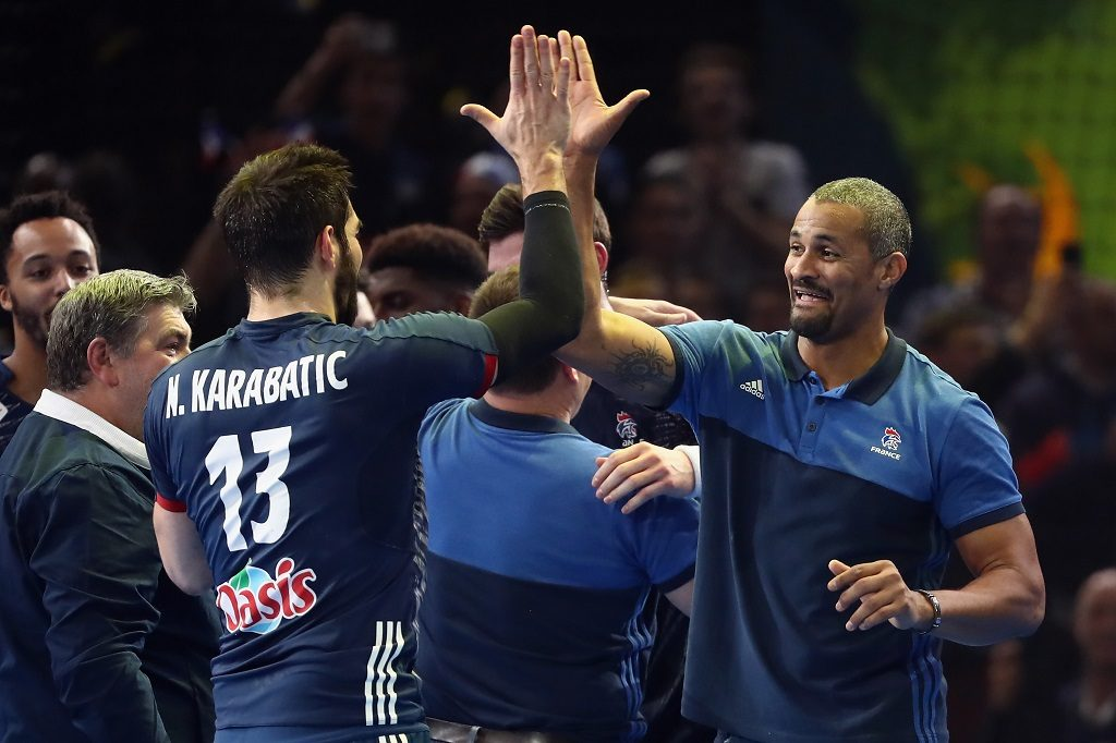 PARIS, FRANCE - JANUARY 26: Head coach Didier Dinart of France shakes hands with Nikola Karabatic during the 25th IHF Men's World Championship 2017 Semi Final match between France and Slovenia at Accorhotels Arena on January 26, 2017 in Paris, France.  (Photo by Alex Grimm/Bongarts/Getty Images)