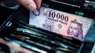 The visage of King Stephen I sits on a Hungarian ten thousand forint currency banknote as its placed inside a cash register in Budapest, Hungary, on Wednesday, Dec. 30, 2015. Hungary's economic growth will slow to between 2.9 percent and 3 percent this year, Hungary's Economy Minister Mihaly Varga told Figyelo. Photographer: Akos Stiller/Bloomberg via Getty Images