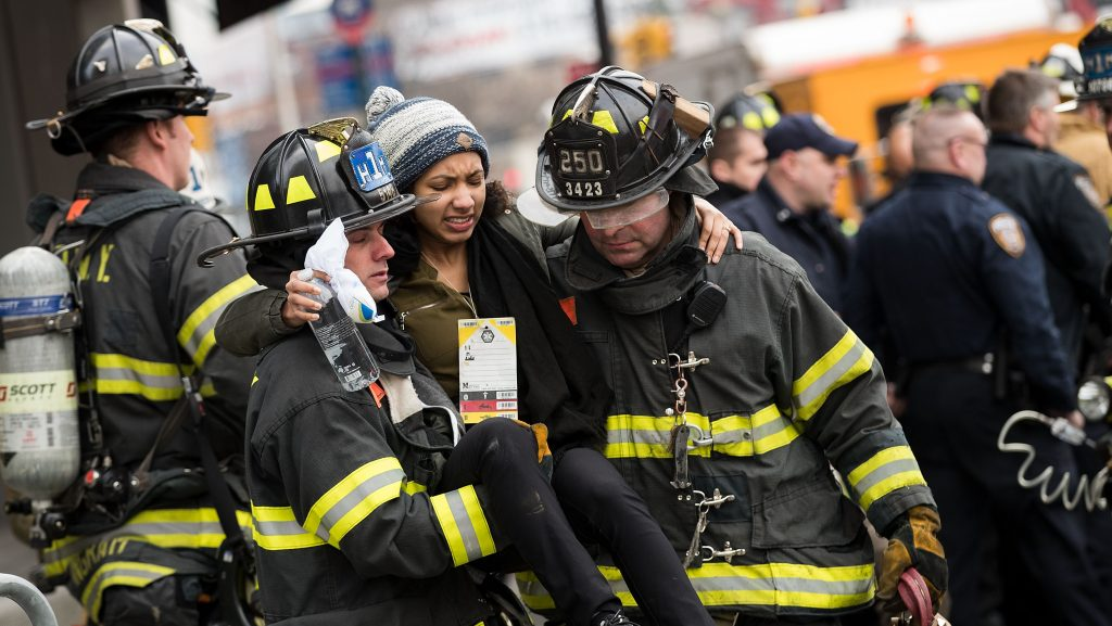 NEW YORK, NY - JANUARY 4: Members of the New York City Fire Department carry an injured person away at the scene of a train derailment at Atlantic Terminal, January 4, 2017 in the Brooklyn borough of New York City. A Long Island Railroad train derailed at Atlantic Terminal on Wednesday morning. (Photo by Drew Angerer/Getty Images)