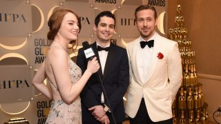 BEVERLY HILLS, CA - JANUARY 08:  (L-R) Actress Emma Stone, director Damien Chazelle, actor Ryan Gosling attend the 74th Annual Golden Globe Awards at The Beverly Hilton Hotel on January 8, 2017 in Beverly Hills, California.  (Photo by Michael Kovac/Getty Images for Moet & Chandon )