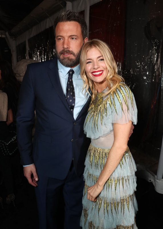 """HOLLYWOOD, CA - JANUARY 09:  Ben Affleck and Sienna Miller attend the premiere Of Warner Bros. Pictures' """"Live By Night"""" at TCL Chinese Theatre on January 9, 2017 in Hollywood, California.  (Photo by Todd Williamson/Getty Images)"""