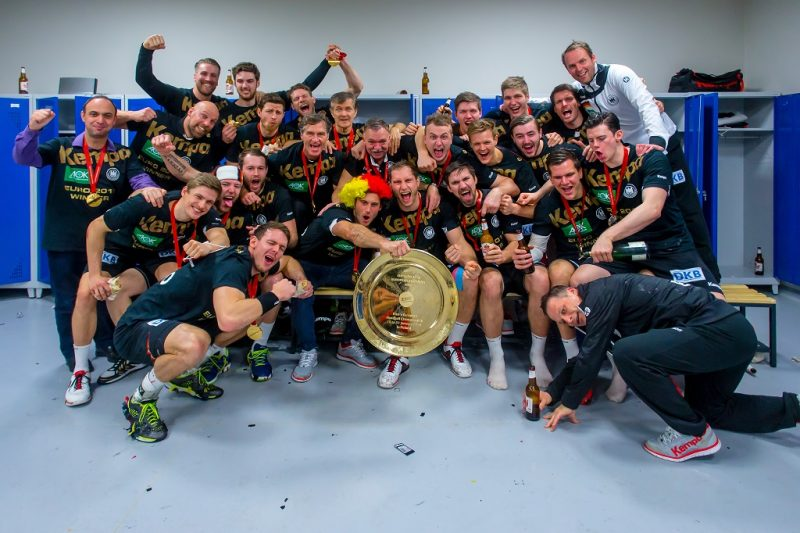 KRAKOW, POLAND - JANUARY 31: The German national handball team hold the trophy as they celebrate victory in the changing rooms after the Men's EHF Handball European Championship 2016 Final match between Germany and Spain at Tauron Arena Hall on January 31, 2016 in Krakow, Poland. (Photo by Sascha Klahn/Bongarts/Getty Images)