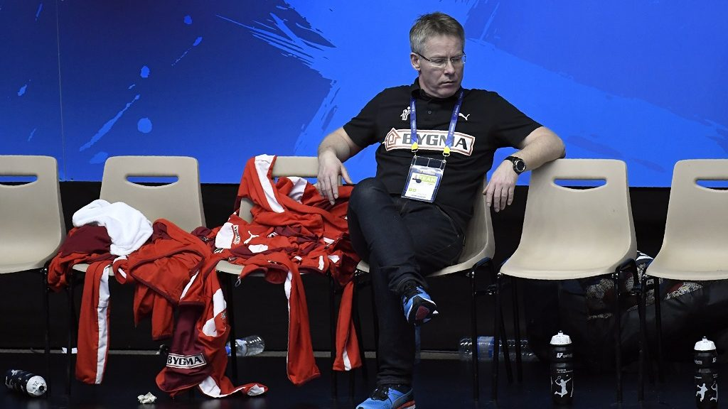 Denmark's icelandic head coach Gudmundur Gudmundsson looks on after losing to Hungary the 25th IHF Men's World Championship 2017 eighth final handball match Hungary vs Denmark on January 22, 2017 at the Halle Olympique in Albertville. / AFP PHOTO / PHILIPPE DESMAZES