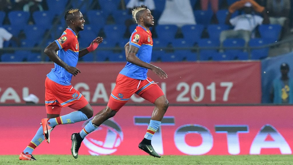 Democratic Republic of the Congo's forward Junior Kabananga (R) celebrates with Democratic Republic of the Congo's midfielder Merveille Bokadi after scoring a goal during the 2017 Africa Cup of Nations group C football match between DR Congo and Morocco in Oyem on January 16, 2017. / AFP PHOTO / ISSOUF SANOGO