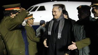 """Marshal Khalifa Haftar (C), the military leader of the so-called Libyan National Army and Libya's parallel parliament based in the eastern city of Tobruk, is greeted upon his arrival at Al-Kharouba airport south of the town of al-Marj, about 80 km east of the Mediterranean port city of Benghazi on December 3, 2016 after his visit in Russia.  / AFP PHOTO / Abdullah DOMA / """"The erroneous mention[s] appearing in the metadata of this photo by Abdullah DOMA has been modified in AFP systems in the following manner: [Marshal Khalifa Haftar, the military leader of the so-called Libyan National Army and Libya's parallel parliament based in the eastern city of Tobruk] instead of [General Khalifa Haftar commander of the armed forces loyal to the internationally recognised Libyan government,]. Please immediately remove the erroneous mentions from all your online services and delete them from your servers. If you have been authorized by AFP to distribute them) to third parties, please ensure that the same actions are carried out by them. Failure to promptly comply with these instructions will entail liability on your part for any continued or post notification usage. Therefore we thank you very much for all your attention and prompt action. We are sorry for the inconvenience this notification may cause and remain at your disposal for any further information you may require."""