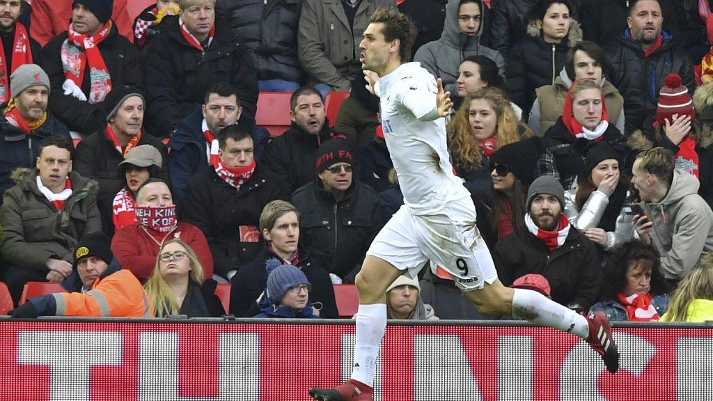 Swansea City's Spanish striker Fernando Llorente celebrates scoring a goal during the English Premier League football match between Liverpool and Swansea City at Anfield in Liverpool, north west England on January 21, 2017. / AFP PHOTO / Anthony DEVLIN / RESTRICTED TO EDITORIAL USE. No use with unauthorized audio, video, data, fixture lists, club/league logos or 'live' services. Online in-match use limited to 75 images, no video emulation. No use in betting, games or single club/league/player publications.  /