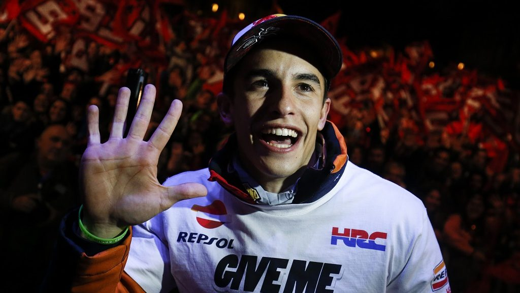 Moto GP world champion, Repsol Honda Team's Spanish rider Marc Marquez, poses during the celebration of his title in his home town of Cervera, near Barcelona, on November 19, 2016.  Marquez claimed his third MotoGP world crown with victory at Motegi, Japan on October 16. / AFP PHOTO / PAU BARRENA
