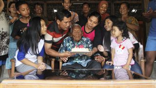 CENTRAL JAVA, INDONESIA - DECEMBER 31 : An Indonesian man Mbah Gotho (C) claimed to be the oldest human in world's history, is seen during his 146th birthday in Sragen, Central Java, Indonesia on December 31, 2016. According to the date of birth on his identity and civil registry office members, he was born on December 31, 1870. (Photo by Stringer/Anadolu Agency/Getty Images)