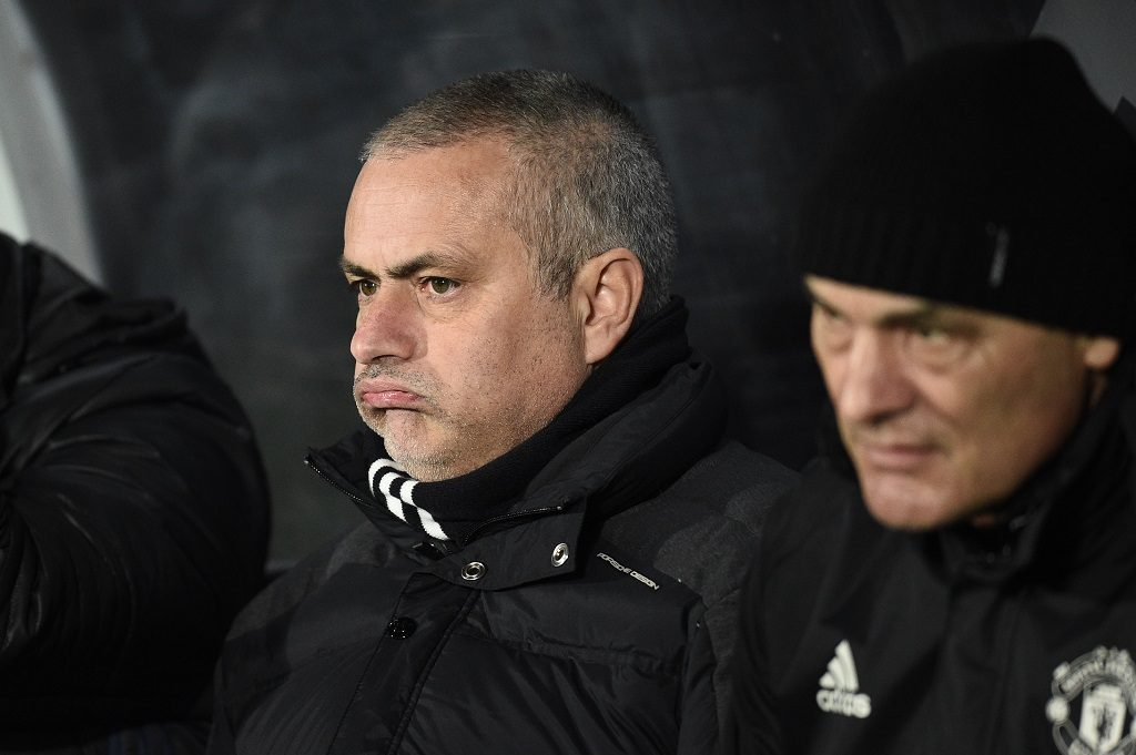 Manchester United's Portuguese manager Jose Mourinho (C) looks on during the EFL (English Football League) Cup semi-final second-leg football match between Hull City and Manchester United at the KCOM Stadium in Kingston upon Hull, north east England on January 26, 2017.   / AFP PHOTO / Oli SCARFF / RESTRICTED TO EDITORIAL USE. No use with unauthorized audio, video, data, fixture lists, club/league logos or 'live' services. Online in-match use limited to 75 images, no video emulation. No use in betting, games or single club/league/player publications.  /