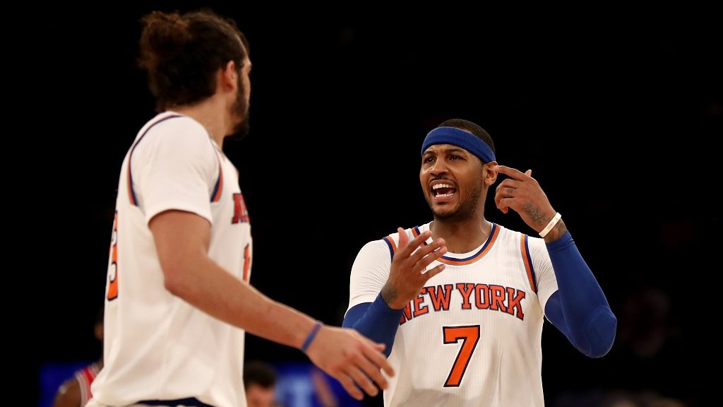 NEW YORK, NY - JANUARY 12: Carmelo Anthony #7 of the New York Knicks talks with teammate Joakim Noah #13 in the second half against the Chicago Bulls at Madison Square Garden on January 12, 2017 in New York City. NOTE TO USER: User expressly acknowledges and agrees that, by downloading and or using this Photograph, user is consenting to the terms and conditions of the Getty Images License Agreement   Elsa/Getty Images/AFP