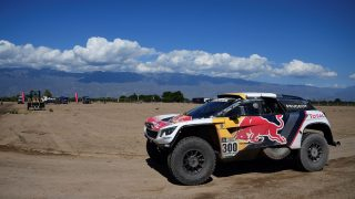 Peugeot's French pilot Stephane Peterhansel and co-driver Jean Paul Cottret arrive in the bivouac in Chilecito, Argentina, on January 11, 2017. A massive mudslide in northwestern Argentina that killed two people and forced more than 1,000 to evacuate has led Dakar Rally organizers to scrap today's ninth stage. / AFP PHOTO / Franck FIFE