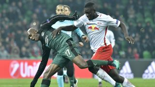Charles Kabore (L) of FC Krasnodar and Dayot Upamecano (R) of FC Salzburg vie for the ball during the UEFA Europa League group I football match between FC Krasnodar and FC Salzburg in Krasnodar, Russia on November 24, 2016. / AFP PHOTO / APA / HERBERT NEUBAUER / Austria OUT