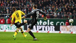 BREMEN, GERMANY - JANUARY 21:   Jaroslav Drobny  of Bremen kicks  Marco Reus of Dortmund leading to his red card during the Bundesliga match between Werder Bremen and Borussia Dortmund at Weserstadion on January 21, 2017 in Bremen, Germany.  (Photo by Stuart Franklin/Bongarts/Getty Images)