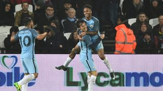 Manchester City's Spanish midfielder David Silva celebrates with Manchester City's English midfielder Raheem Sterling (up) and Manchester City's Argentinian striker Sergio Aguero (L) after scoring their third goal during the English FA cup third round football match between West Ham United and Manchester City at the London Stadium in east London on January 6, 2016.  / AFP PHOTO / Justin TALLIS / RESTRICTED TO EDITORIAL USE. No use with unauthorized audio, video, data, fixture lists, club/league logos or 'live' services. Online in-match use limited to 75 images, no video emulation. No use in betting, games or single club/league/player publications.  /