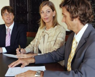 Three business colleagues in meeting