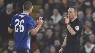 Chelsea's English defender John Terry (L) reacts just before Kevin Friend shows him a red card after a challenge on Peterborough United's English striker Lee Angol during the English FA Cup third round football match between Chelsea and Peterborough at Stamford Bridge in London on January 8, 2017. / AFP PHOTO / Glyn KIRK / RESTRICTED TO EDITORIAL USE. No use with unauthorized audio, video, data, fixture lists, club/league logos or 'live' services. Online in-match use limited to 75 images, no video emulation. No use in betting, games or single club/league/player publications.  /