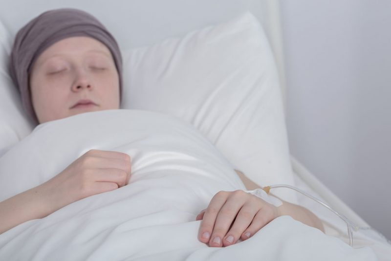 Picture of girl with cancer during therapy in hospital