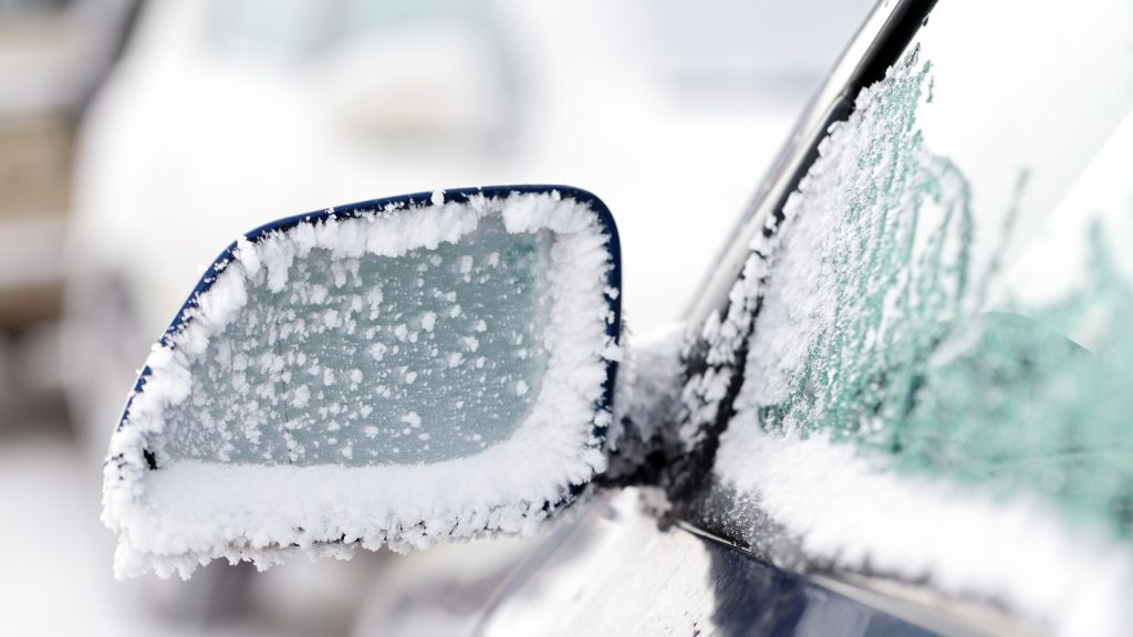 Picture of an iced car mirror and window